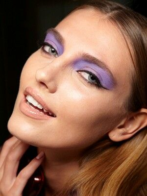 Dramatic purple eyes and neutral lips