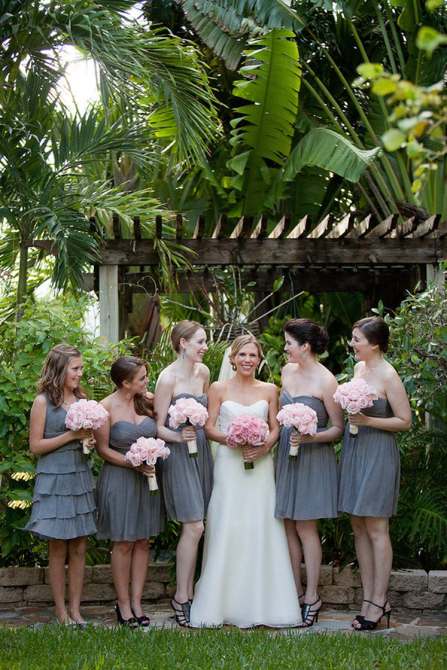 Four seasons palm beach wedding by captured photography by jenny bridesmaid grey bridesmaid dresses with pink flowers ombrellifo Images