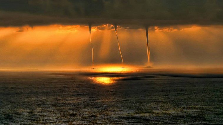 In the Mediterranean sea, you can happen to spot a view like this: 3 waterspouts in the sunset (link/credits in ES) http://bit.ly/2jenr7R