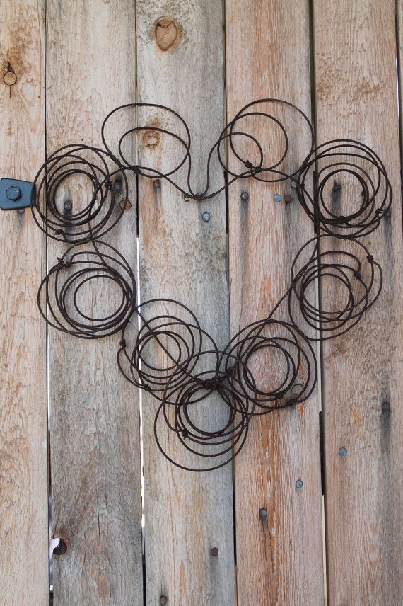 rusted wire heart made from old springs from by jackrabbitflats