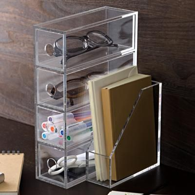 muji acrylic organizer    http://www.muji.us/store/stationery/desk-accessory/acrylic-case-for-glasses-and-small-items.html