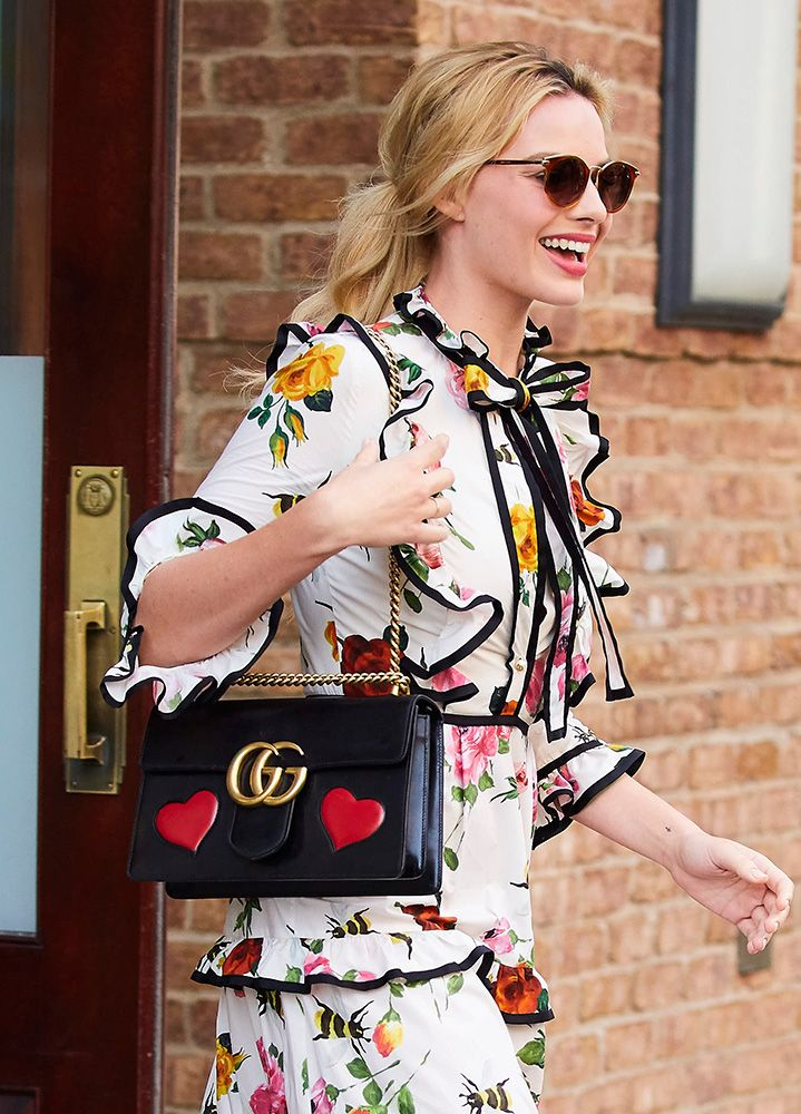 4116b84c8173f8 Celebs Hit the Press Circuit with Bags from Gucci, Versace, Chanel and More