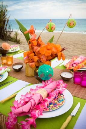 tropical Flower Arrangements Centerpieces   To add a tropical flare to your table setting, add flowers such as ...