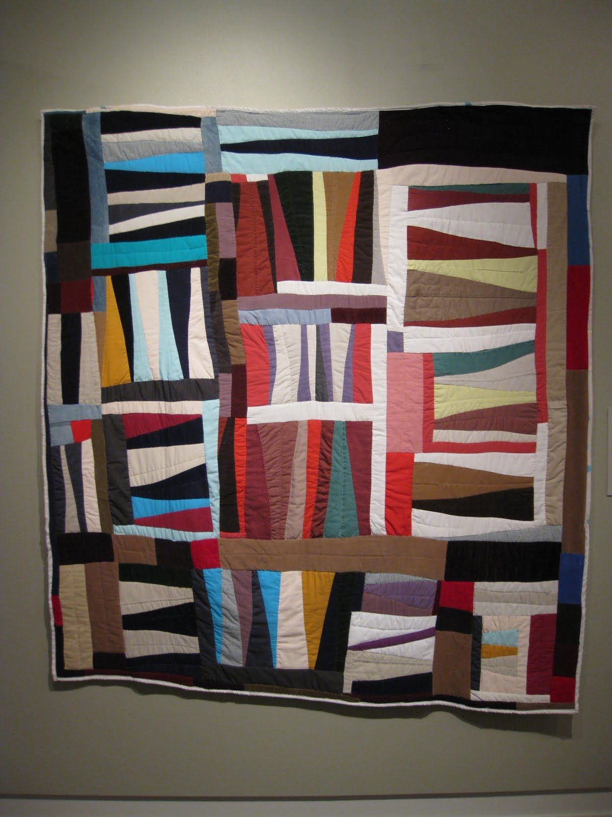 "This is an African American quilt made by Mary Lee Bendolf called ""Strings."" This is a beautiful non-western design and I love the contrast of the light and dark colors she incorporated into her design."
