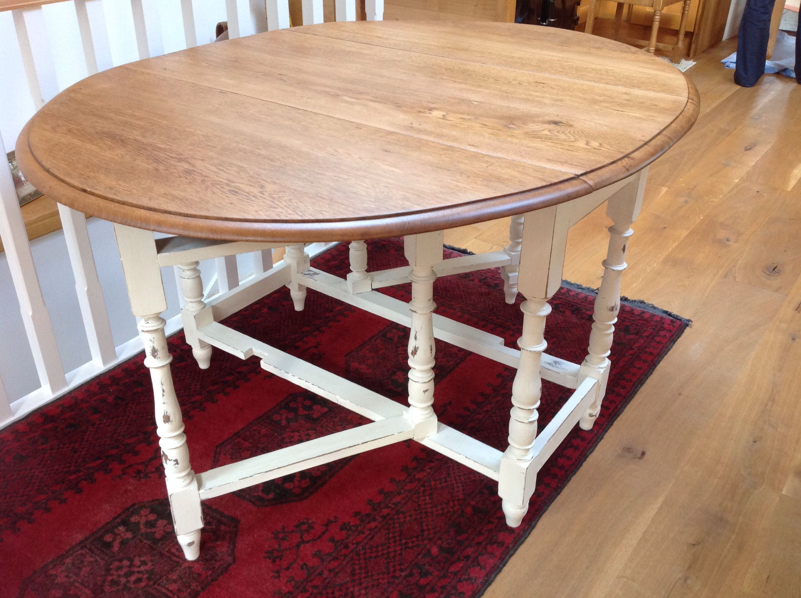 Oak Gate Leg Table, Seats Six, Painted And Waxed Legs, Varnished Top.