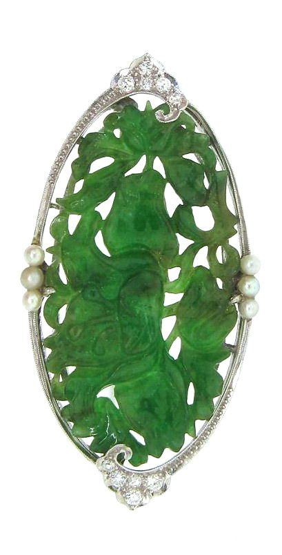 Circa 1920s platinum, jade, diamond, and pearl Art Deco brooch.