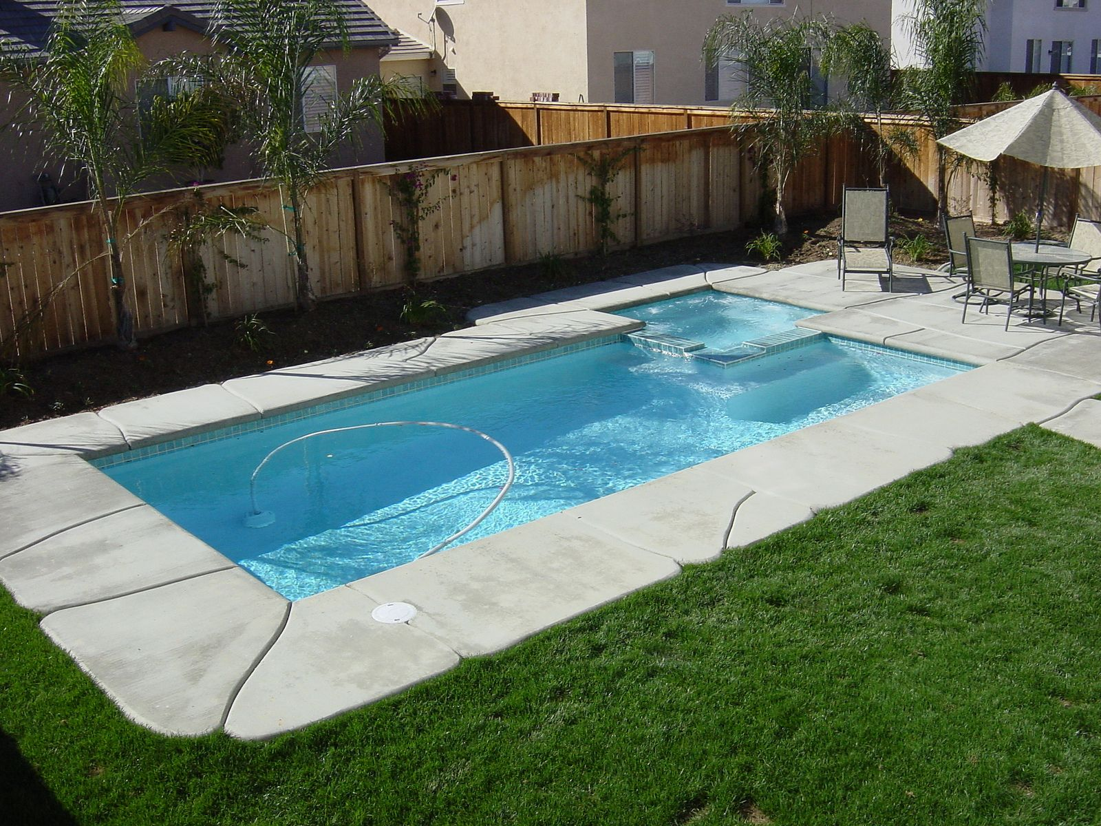 Swiming pools swimming pool design with outdoor umbrella design also stainless patio chair and - Pool patio design ...