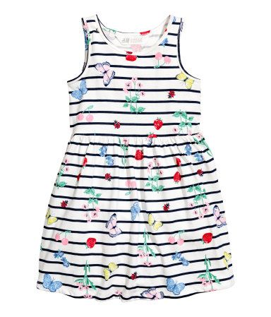 c8bcd8707 Sleeveless dress in soft cotton jersey with a printed pattern. Gathered  seam at waist and flared skirt.