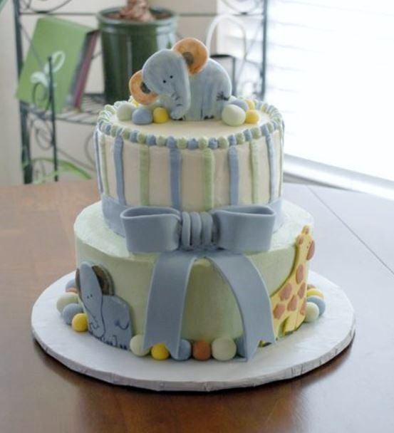 Delightful 2 Tier Baby Shower Cake With Elephant On Top And Light Blue Bow.JPG