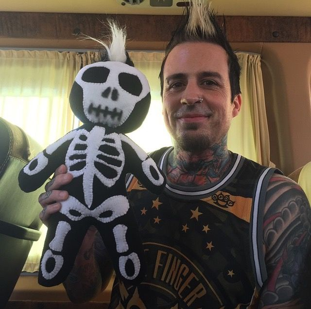 Jeremy Spencer of FFDP with a doll made to look like him on stage. From the people of Russie