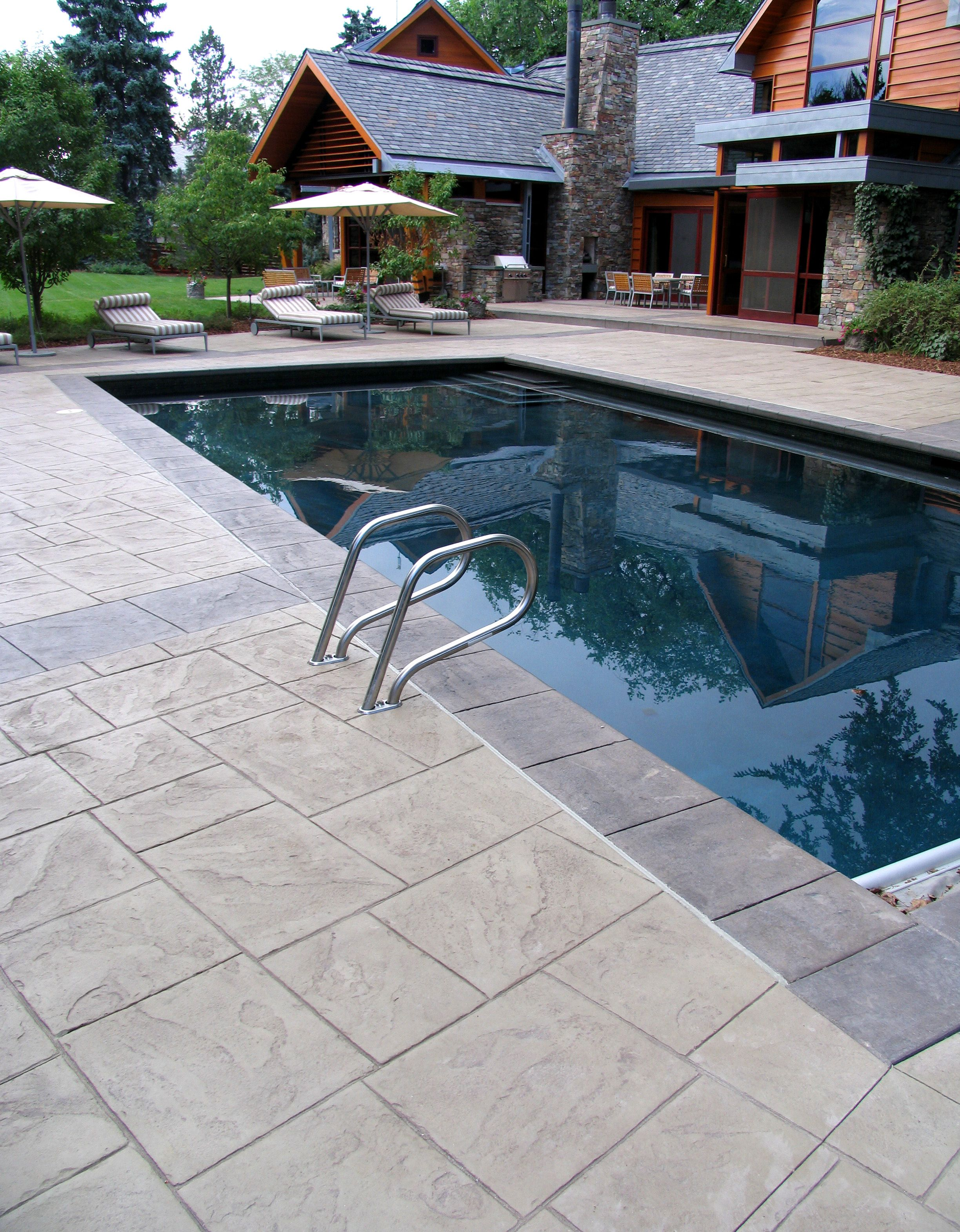 Bomanite integrally colored stamped concrete patio pliments the