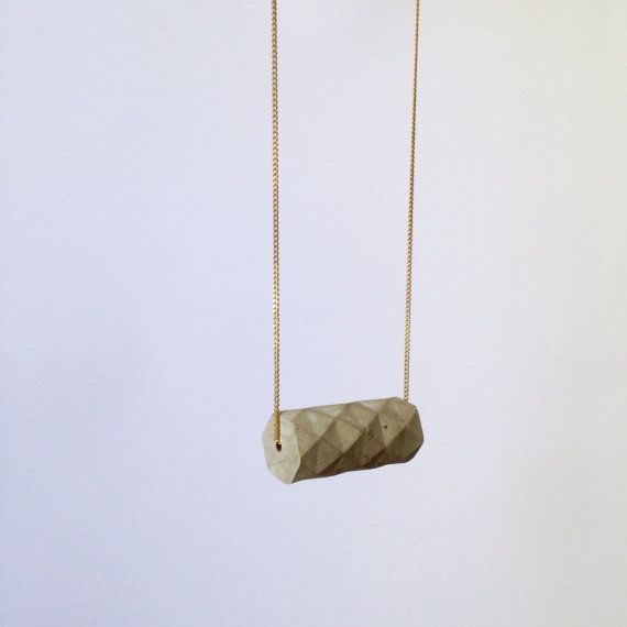 The Concrete Origami Cylinder Is Casted Around A Raw Brass Original Geometric Form