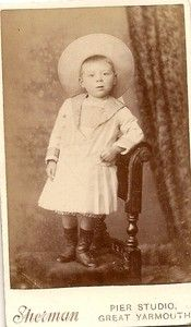 Vintage cabinet card of little boy in dress