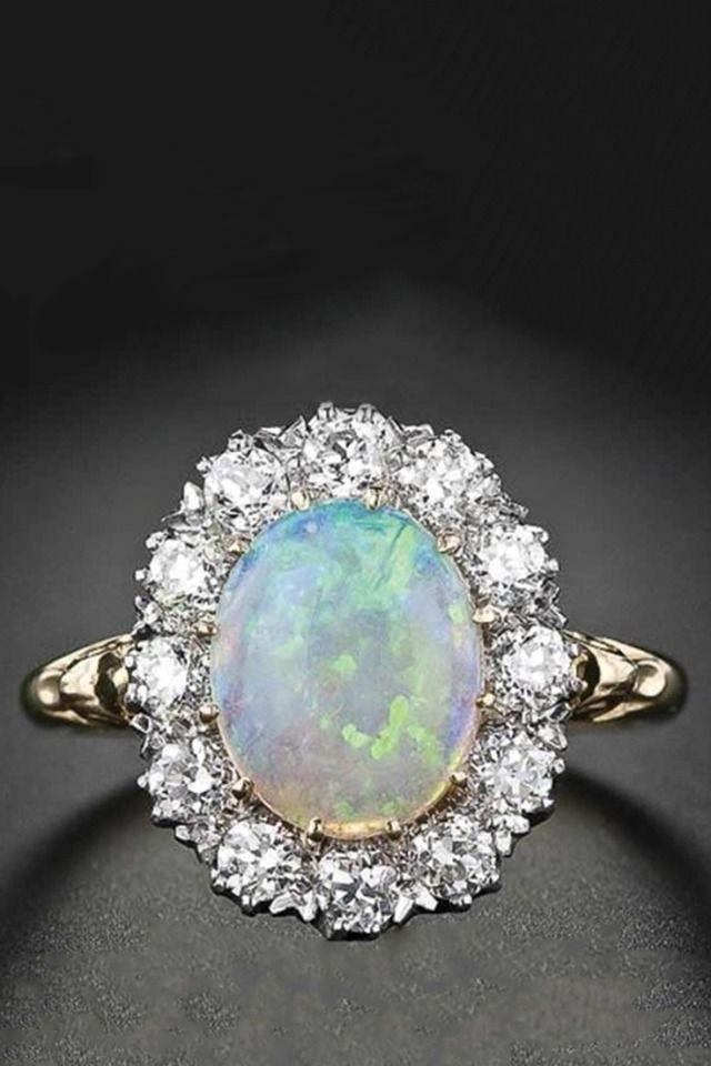 968df1847ff9bf Looking for a non-traditional engagement ring? Try iridescent opals, they  add depth