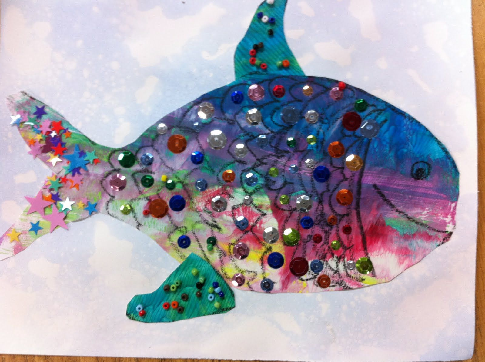 I start this project by having each child make a bubble for Fish art and craft