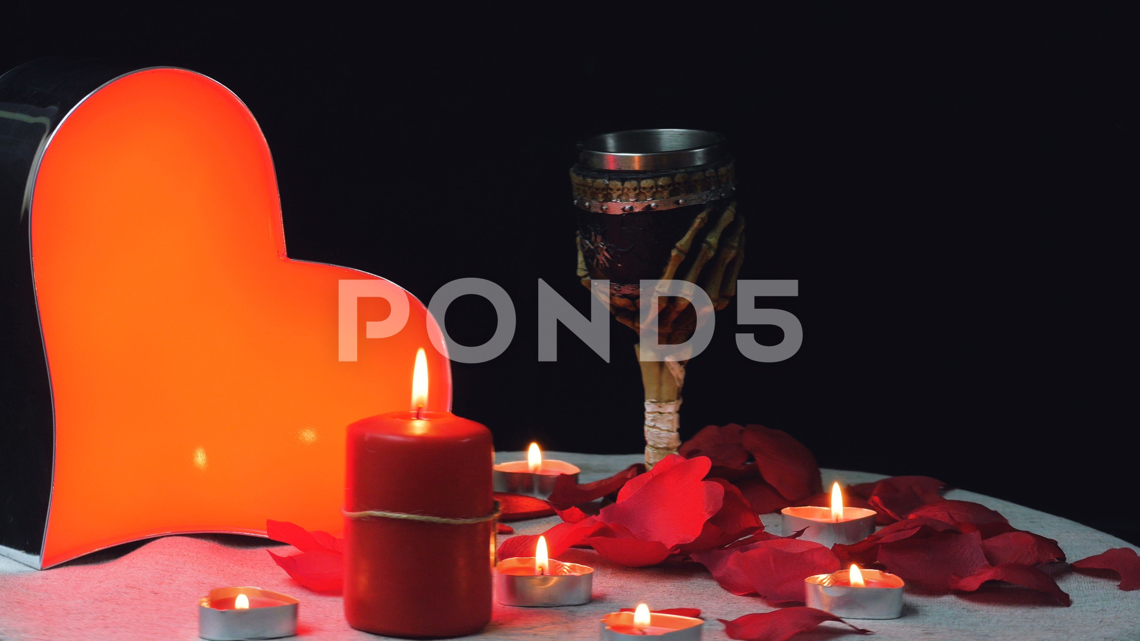 Design Gothic Candles glowing heart with flames candles and rose petals gothic cupe rotation valentine