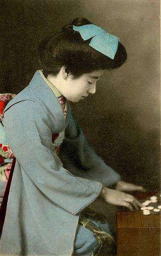 Geisha Eiryu playing GO 1910s. Eiryu playing the Japanese board game, GO.