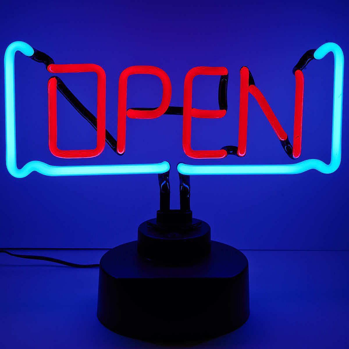 """OPEN Neon-Lampe """"Open""""    The American Way of Light: Die Open-Neon Lampe im stylishen Look zeigt leuchtend an, dass Sie und Ihre Wohnung für Spaß mit Freunden und ein gemeinsames Essen gerade absolut offen sind.    Größe: Breite 25 x Tiefe 8 x Höhe 37 cm  Material: Glas, Kunststoff..."""