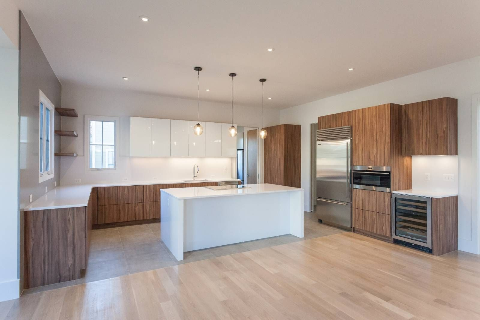 Modern Kitchen With White High Gloss And Striated Wood Cabinets In Custom Contemporary Home By Bcn Homes In Arl Modern Kitchen Contemporary House Wood Cabinets