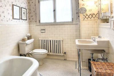 """Nice tub (like ours) and like simple old style tile, accordion mirror, cup holder. Pretty window---good for master bath. Like that sink has """"upper deck"""" for soap, etc. Mt Baker/"""