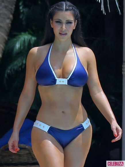 b06c2acb7ac Kim Kardashian rocks this blue bikini while vacationing in the Dominican  Republic. Bam