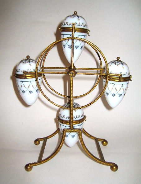 A Signed BACCARAT Opaline Big Wheel comprising of Four Opaline eggs, each individually signed BACCARAT.