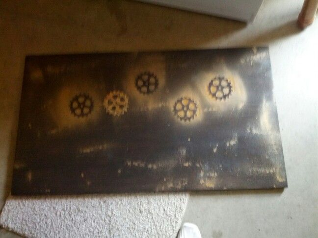 I made a gear stencil and spray painted it on the board to get this effect.