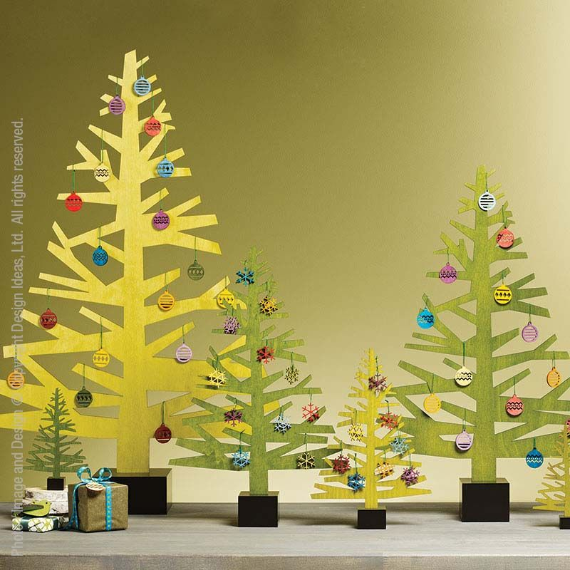 Before the glitz and glamour the holidays began as a simple, elegant celebration. We've tried to capture that simple elegance with our Alpine™ trees made from carefully cut sheets of poplar. These trees form a festive backdrop for a buffet, mantel or side table. Hang ornaments from the branches or create your own winter forest.