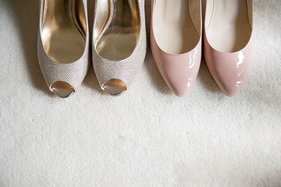 Peep toe shoes for the bridesmaid and baby pink Jimmy Choo shoes for the bride at a wedding at Coworth Park (C) Fiona Kelly Berkshire wedding photographer