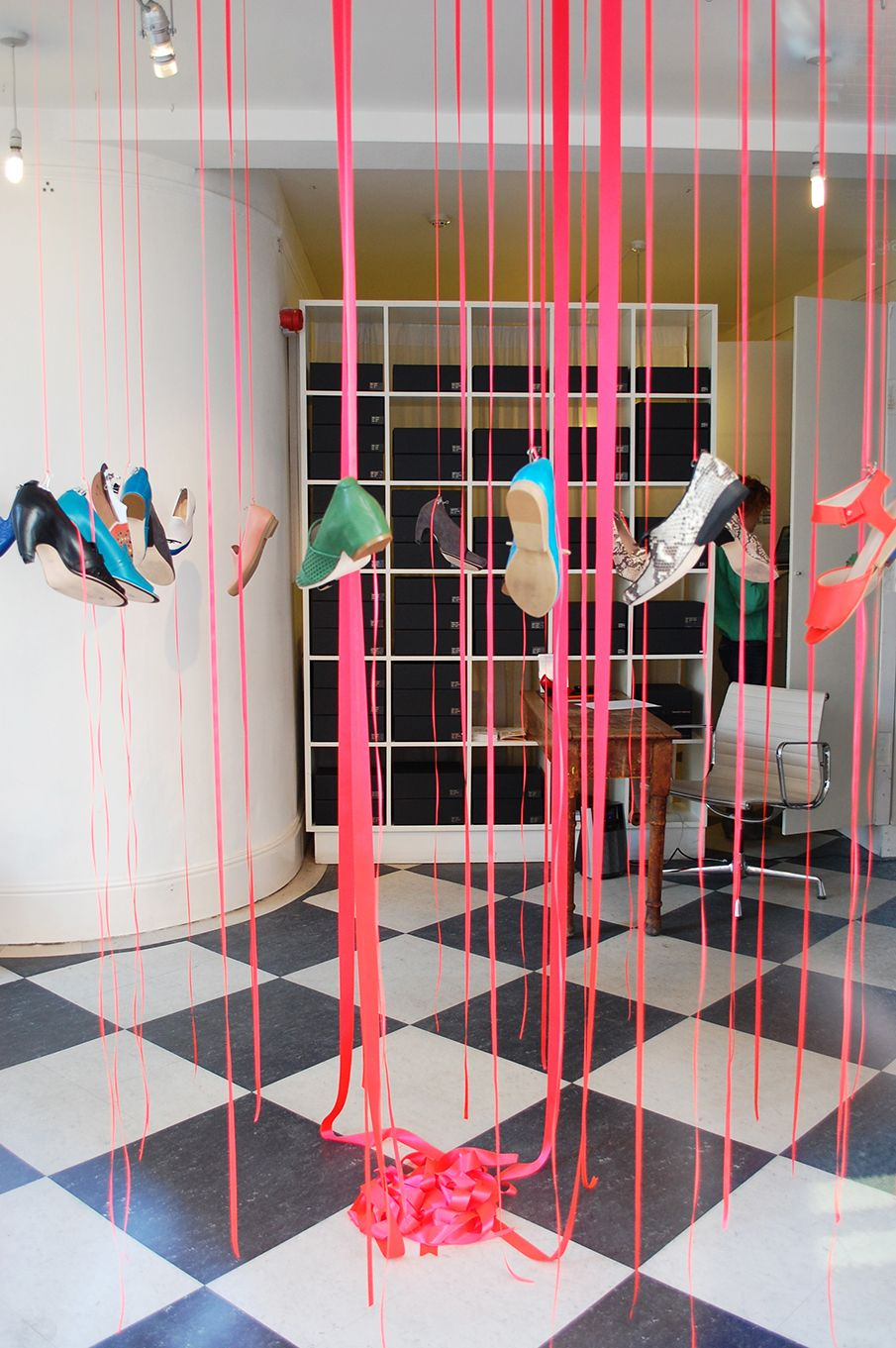 Hanging shoes in pink strings