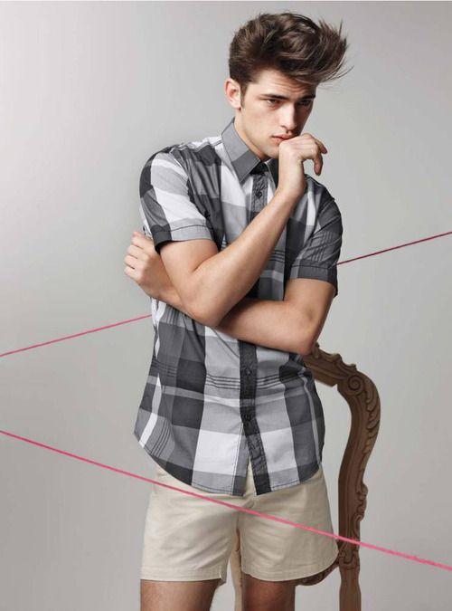 Men's short sleeve plaid shirt and khaki shorts