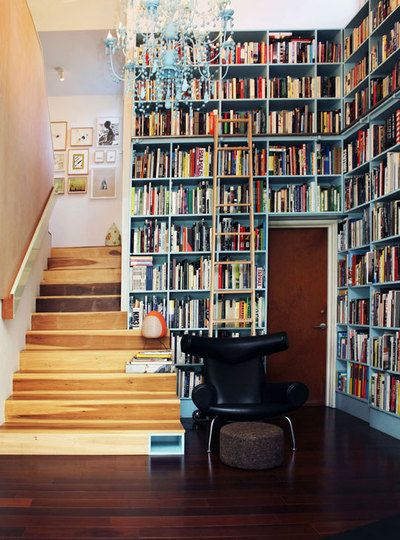 Some day I would love to have a full-wall book shelf that required the use of a sliding ladder! Ideally, it would also have wine storage...