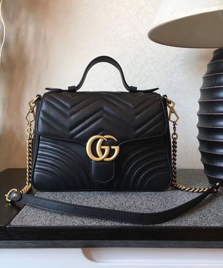 3819a79d7023 The Gucci GG Marmont small top handle bag is practical . You get a top  handle