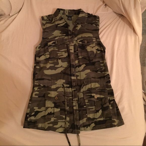 Camouflage vest with drawstring Camouflage vest with drawstring waist and front pockets. Very comfortable and goes great with anything. Only worn once!! Cotton Express Other