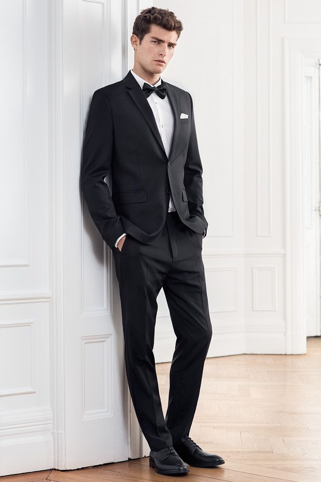 Wedding guest or bride groom, a black suit always looks good. Add a ...