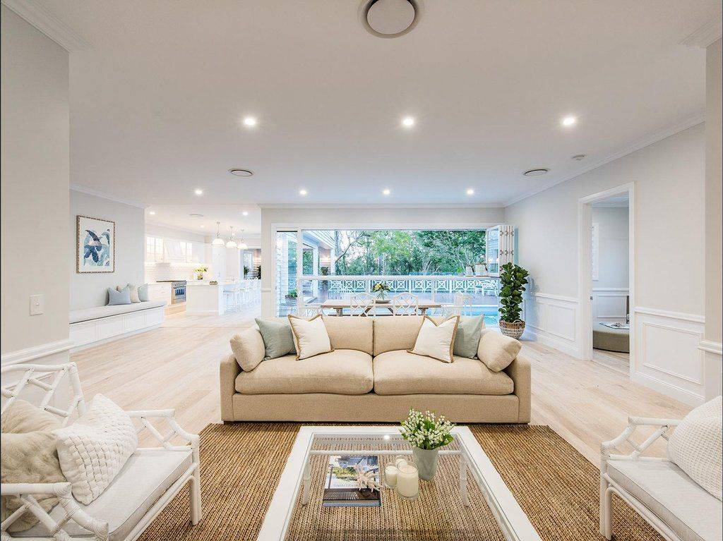 Stunning hamptons queenslander style home in brisbane for Queenslander living room ideas