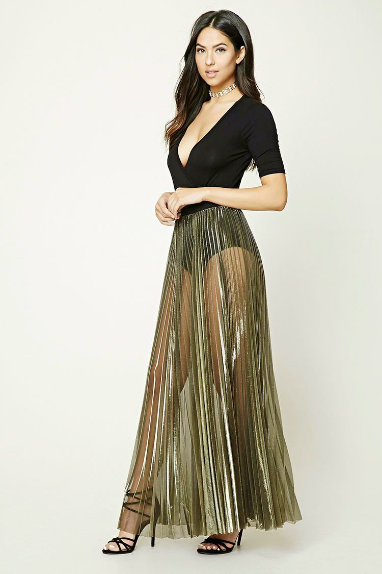 c9bc9bf09e A metallic sheer knit skirt featuring allover accordion pleats and a  contrast grosgrain ribbon trim on elasticized waist.