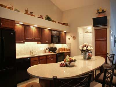 Kidney Shaped Kitchen Island | Woodstar Kitchen With Kidney Shaped  Silestone Countertop