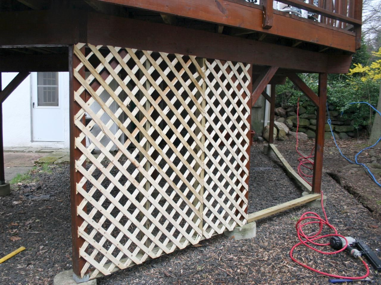 Adding lattice to the bottom of a deck outdoor spaces for Outdoor lattice