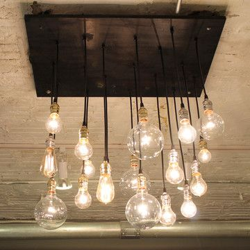 Urban Chandelier made from reclaimed wood, silver hardware and Edison bulbs. Love.