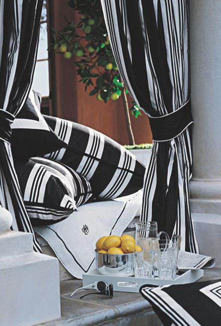 Ralph lauren home black and white striped fabric creates a chic bold cabana