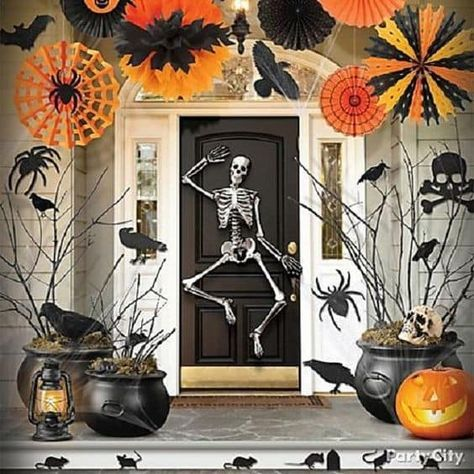 Skeleton Front Door Via Party City Frighteningly Fun Halloween Door Ide Halloween Outdoor Decorations Halloween Porch Decorations Fun Outdoor Halloween Decor