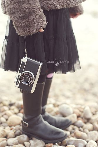 Young girl with an old camera