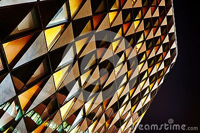 681ebb315cf Office glass building at night. Glass building in abstract ...