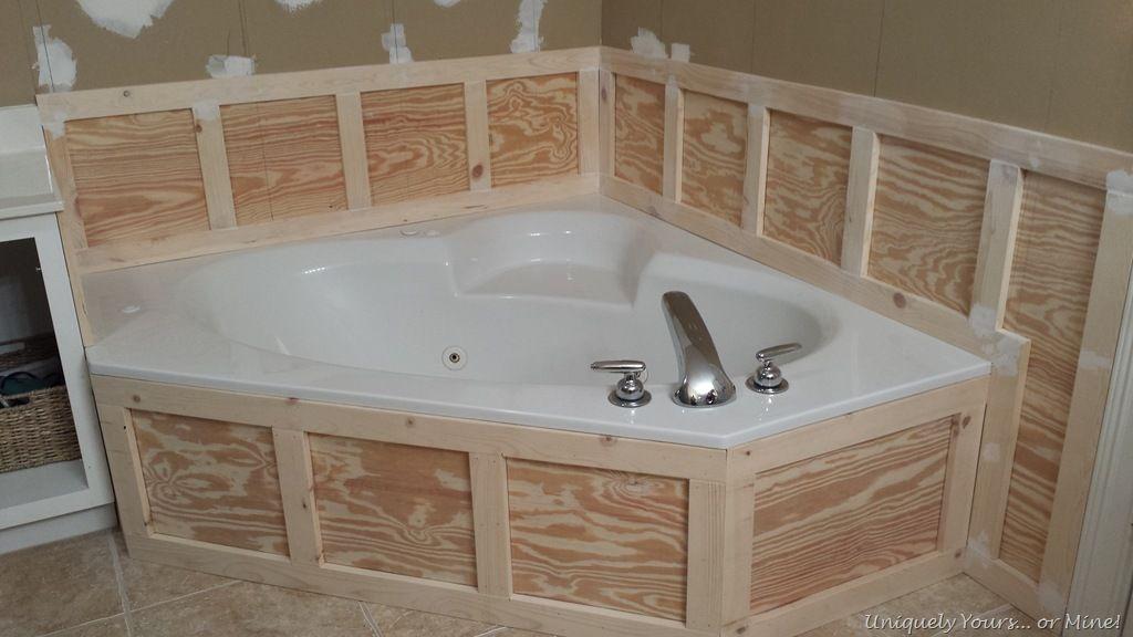 Installing wainscoting around bathtub in master bathroom | Breck ...