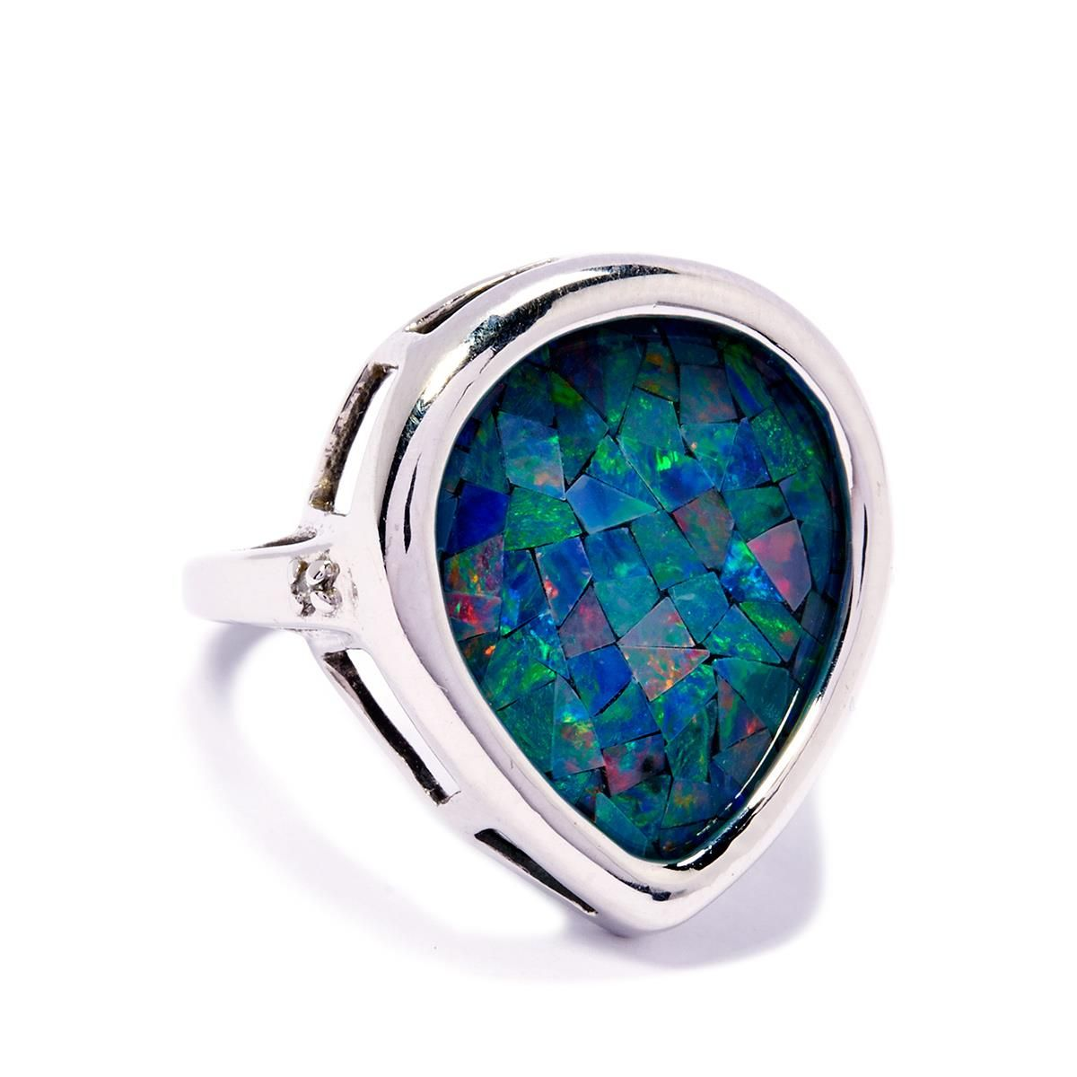 A classically designed Ring from the Jacque Christie collection set into 9k White Gold featuring Mosaic Opal with dazzling Diamonds.