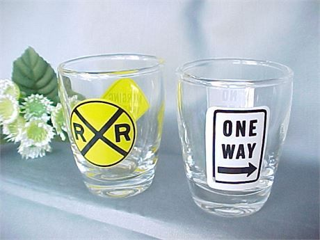 Barware pair of street sign jiggers. One says No Left Turn on one side and One…