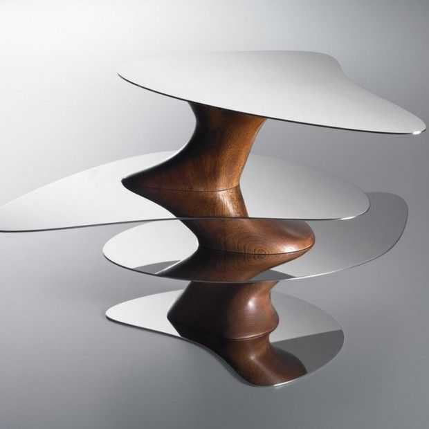 Floating Earth  by Yansong Ma //    Chinese architect Ma Yansong has designed the Floating Earth tray for Alessi. The tray has beautiful wood tones combined with metallic planes to achieve a very luxurious effect.