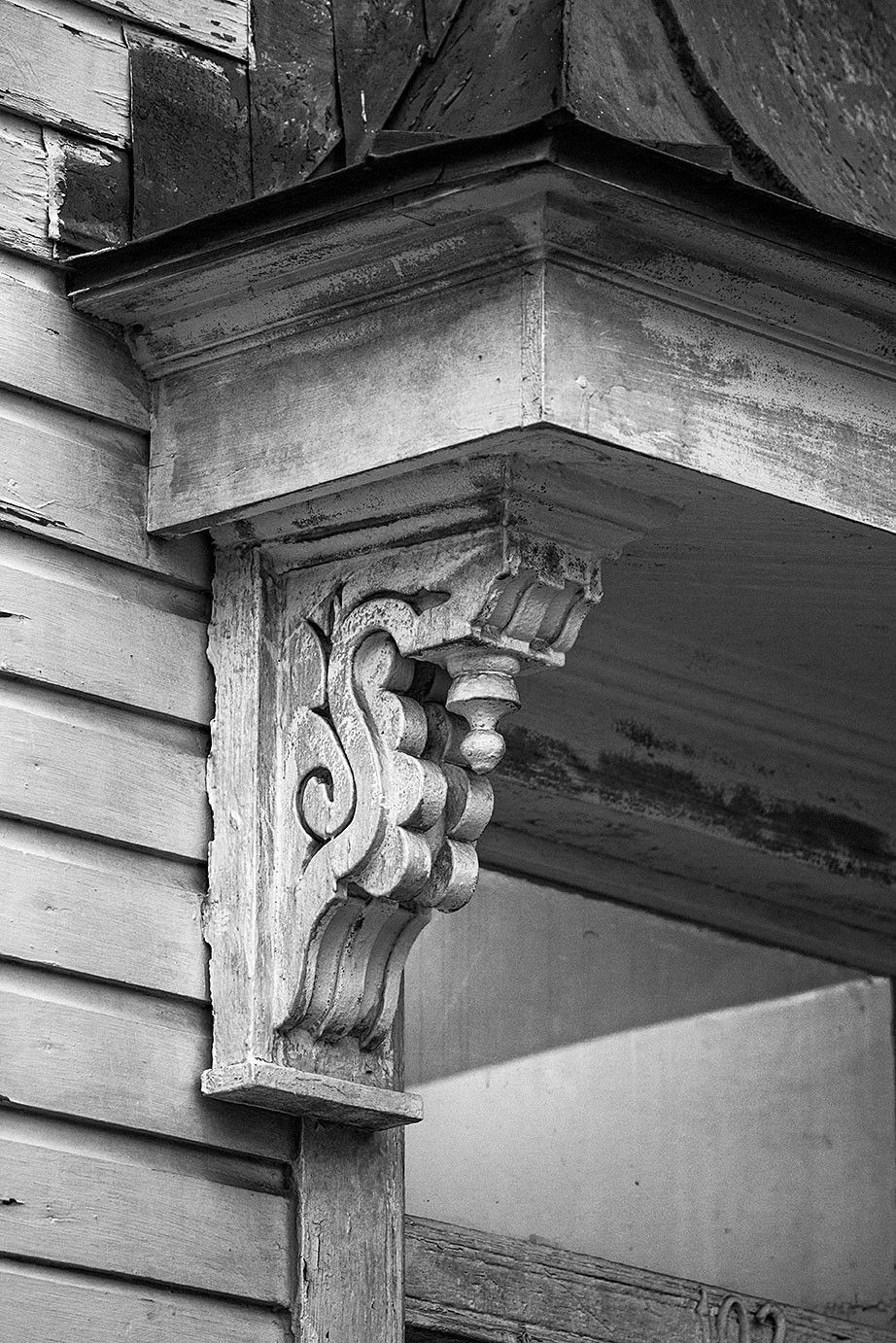 Black And White Architectural Detail Photograph Of Antique Wooden Corbel Under The Eave Of A Porch An Old House In Brick Exterior House Wooden Corbels Corbels