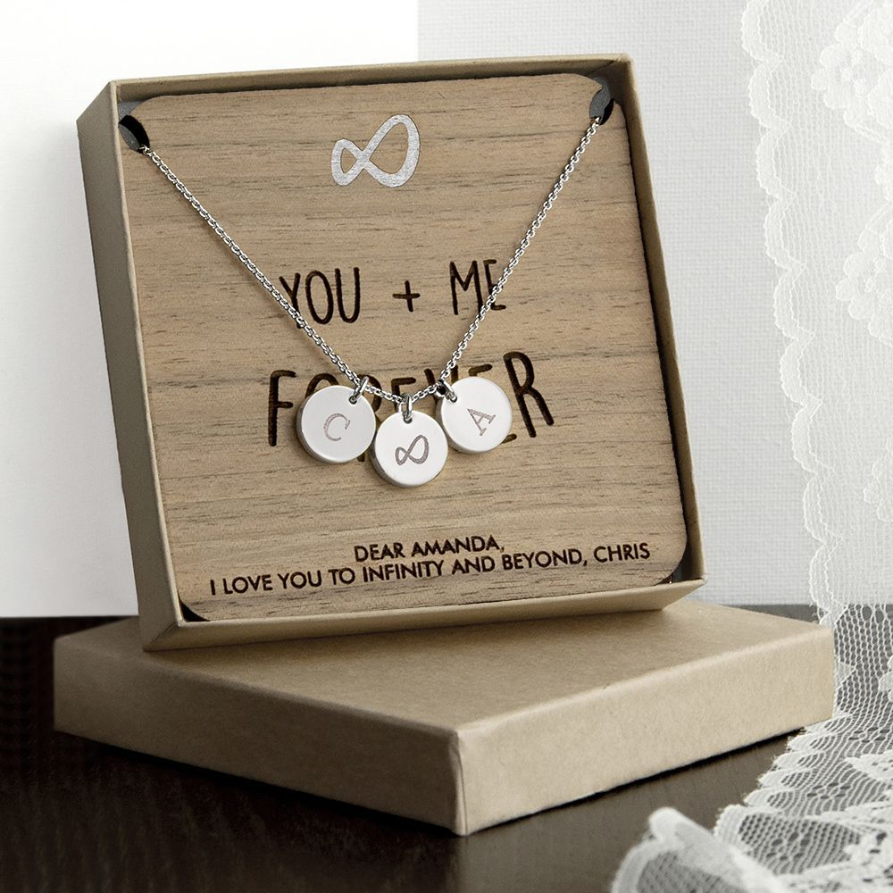 Personalise the necklace with two initials and choose from either rose gold silver or gold necklace charms The wooden keepsake is made from Walnut